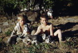 Raymie Redington and Joe Redington Jr. with puppies at Knik.