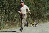 Joe Redington Sr. training sled dog puppies at Knik.