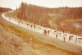 Two hundred dog teams on Knik Goose Bay Road to celebrate Centennial, 1976.