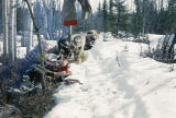 Vi Redington changing socks while camped with dog team on the Iditarod Trail.