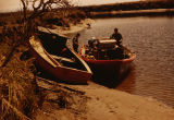 Joe Redington Sr. with two boats on the shore of Seal Slough.