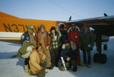 People involved in the 1983 All Alaska Sweepstakes pose in front of airplane in Nome.