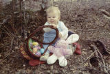 Keith Redington posing with an Easter basket.