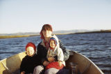 Joee Ray, Pam, and Heather Redington in a boat.