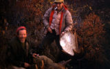 Frenchy Lamoureux and another hunter with a dead moose.