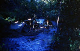 Camp set up along creek in unknown location.