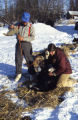 Joe Redington Sr. and Susan Butcher tube watering a dog.