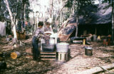 Raymie Redington and Vi Redington doing laundry at the Redington Flat Horn homestead.