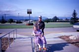 Joe Redington Sr. pushing the wheelchair of Cora Hoffman, Vi Redington's mother, outside the...