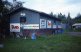 Building at Joe Redington Sr.'s kennel with  sponsor posters on the outside walls.
