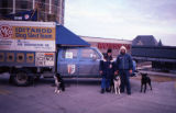 Joe Redington Sr. and John Patton pose with dogs and dog truck in Minnesota before or after the...