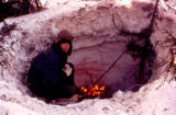 Dave Olson building a fire on the Iditarod Trail.