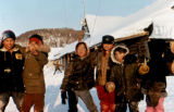 Children at a checkpoint along the Iditarod Trail Sled Dog Race.