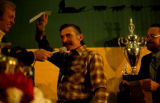 Dick Mackey receives awards at the Nome banquet after winning the 1978 Iditarod Trail Sled Dog...