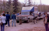 Duane Lambert in front of Joe Redington Sr.'s dog truck at the Iditarod Race headquarters...