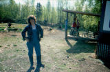 Marcie Heckler in front of sled dog exercise wheel.