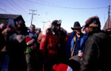 Roger Legaard and son, Cowboy Smith, Dave Olson in Nome after the Iditarod.