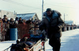 Joe Redington Sr. finishing the Iditarod Trail Sled Dog Race in Nome.