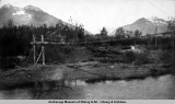 Bridge made of telegraph wire along right of way of V[aldez] Y[ukon] R[ailwa]y, Valdez, 1906.