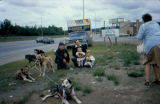 Joe Redington Sr. with two children and man by the Kashim Inn, one of Joe Redington's sponsors in...