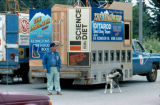 Joe Redington Sr. and sled dog beside truck at the Colony Days Parade in Palmer.