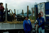 Vi Redington and Joe Redington Sr. with sled dog in front of truck at the Colony Days Parade.