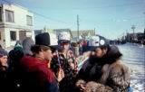 Burt Bomhoff fan club awaits the arrival of Burt Bomhoff on Front Street in Nome.