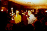 Joe Redington Sr. holding trophy in Nome, with Dick Wilmarth (center) and Orville Lake (right).