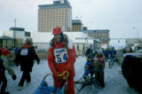 Musher Roger Legaard leaves downtown Anchorage by dog team on the 1983 Iditarod Trail Sled Dog...