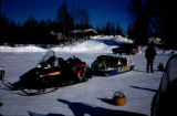 Snowmobile with loaded sled in a parking lot, for Joe Redington's Iditarod Challenege.