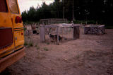 Part of Joe Redington Sr.'s dog lot, with school bus in the foreground.