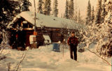 Dick Mackey standing outside cabin in Rohn.