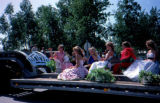 Float of parade queens in formal gowns in the July 4 Wasilla Parade.