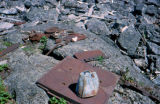 Rusty, broken pieces of scrap metal on a rocky mountain on or near the Chilkoot Trail.