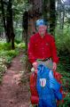 Joe Redington Sr. with a frame backpack and Iditarod winter jacket, on the Chilkoot Trail.
