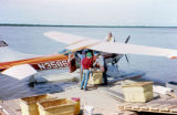 Loading fish onto plane at Pitkas Point, where Joe Redington Sr. bought fish.