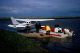 Float plane and boat at floating dock.