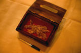 Box containing a gold nugget.