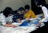 1978 Iditarod Champion Dick Mackey signing a print of Machetanz's 'Reaching the Pass.'