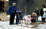 Joe Redington Sr. poses with children next to his dog sled at a presentation at the University...