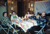 Vi Redington, Cora Hoffman, Lila Legaard, two Legaard sons, Roger Legaard sitting around the table...