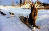 Joe Redington Sr. poses with a dog team and dog sled.