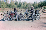 Motorcycle tourists visit Joe Redington Sr.'s dog lot.