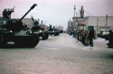 Tanks parade down Fourth Avenue in Anchorage.