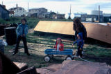 Emelita Brown, Heather Redington, Joee Ray Redington, and Leona Brown playing outside in...