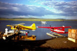 Planes along a shore line in Unalakleet.