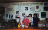 Four people pose inside Don's Iditarod Cafe.