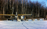 Airplane and dog team on Knik Lake for publicity photo shoot.