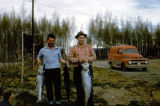 Joe Redington and Jim Moody pose holding salmon at mile 6 of Seward Highway.