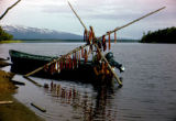 Joe Redington Sr.'s river boat, built by Bob Bacon, with salmon drying in the background.